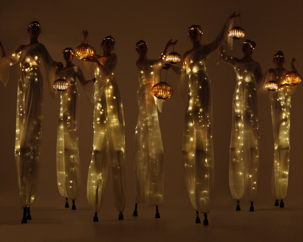 LEd light themed stilt walkers