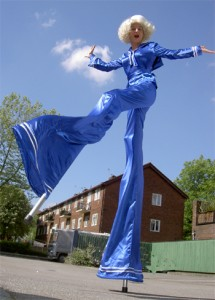 Our Blue interactive stilt walker