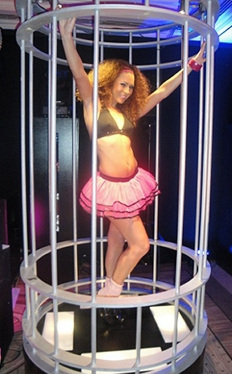 Club Dancer in Cage