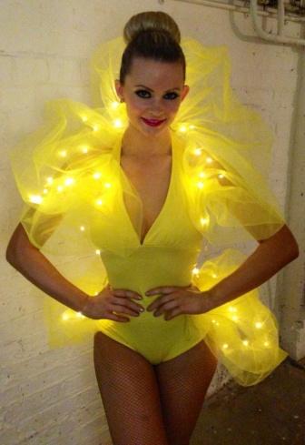 Yellow Stilts Club Dancer