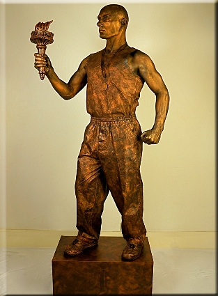 Painted human statue with torch
