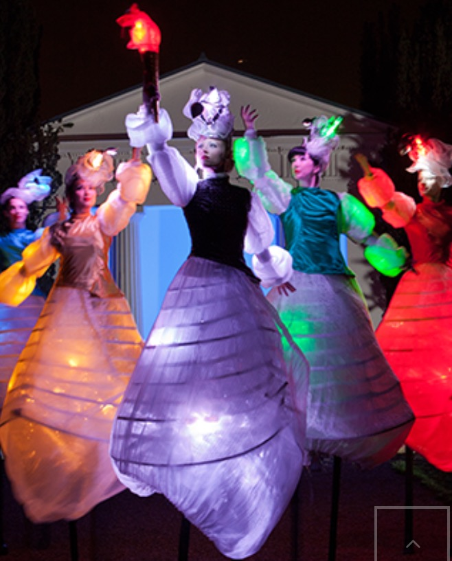 shining and colourful LED stilt walkers