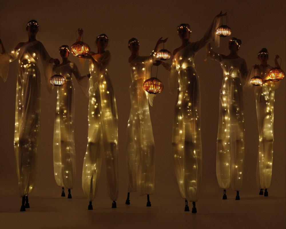 LEd light themed stilt walkers