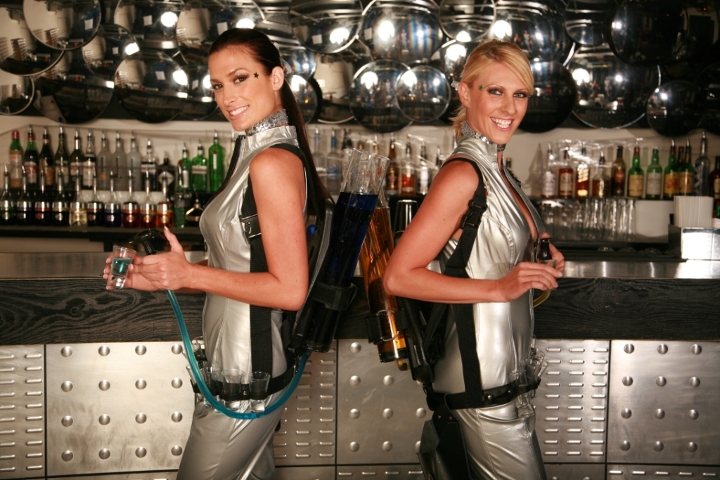 Futuristic drinks dispenser girls working at an event.