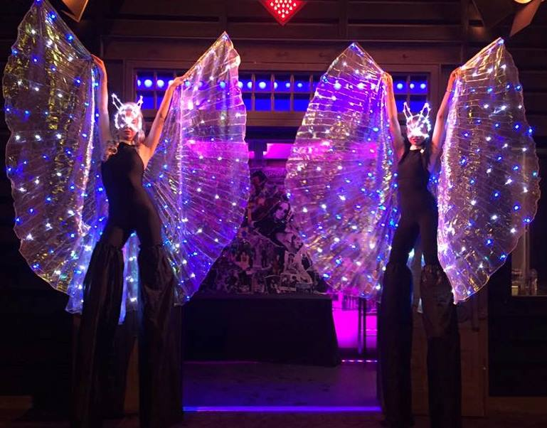LED winged stilt walkers