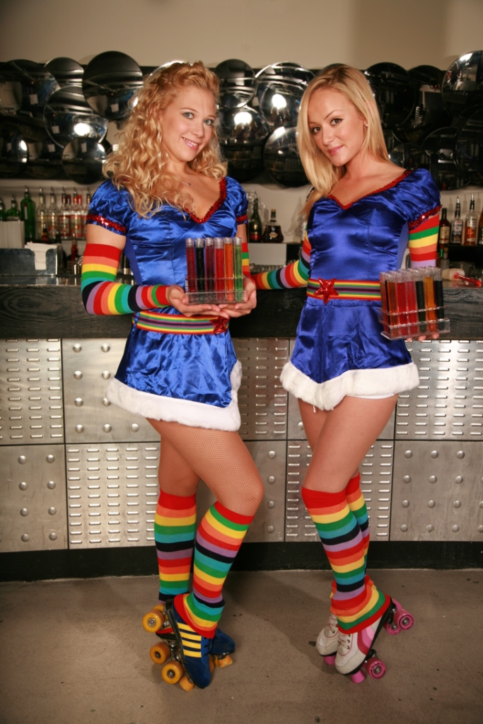 Test tube roller babes entertaining at an event.
