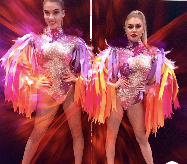 Birds of a feather podium costumes